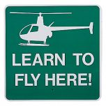 Learn To Fly Here Sign (with Helicopter)