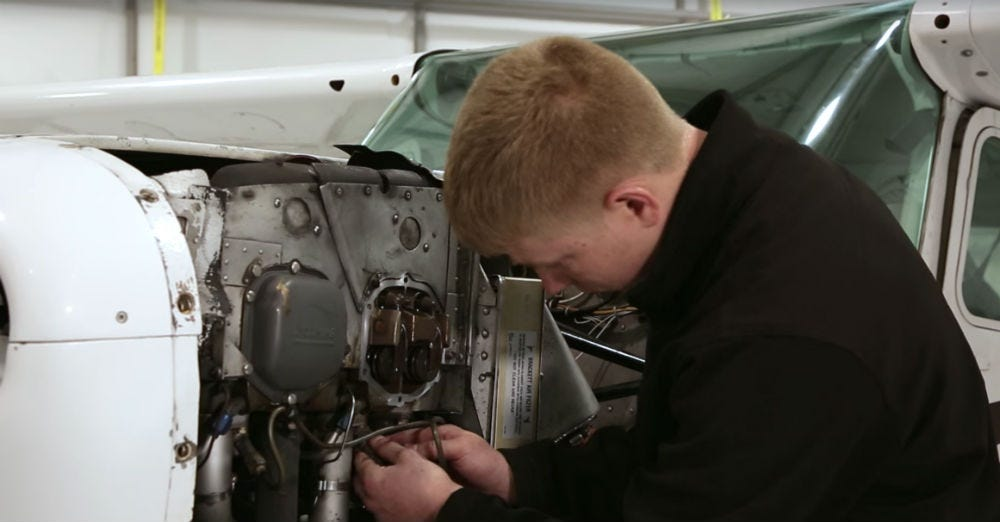 Mechanic working on 172